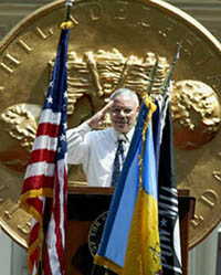 U.S. Secretary of State Colin Powell salutes as flags pass at Independence Hall in Philadelphia Thursday, July 4, 2002, after Powell was presented with the 2002 Philadelphia Liberty Medal.  The medal honors an individual or organization that demonstrates leadership in the pursuit of liberty and freedom from oppression and ignorance.  (AP Photo/Rusty Kennedy)