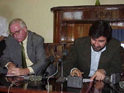 U.S. Ambassador Robert P. Finn (left) and Afghan Commerce Minister Sayed Mustafa Kazemi sign an agreement in which the United States, through a grant from the U.S. Agency for International Development, will provide the Ministry with an Internet Center and 10 computer terminals.  The Center, worth $50,000, will allow Afghan businessmen to sell their products and services on-line to clients worldwide.