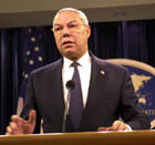 Secretary Powell standing at podium during briefing on Iraq