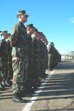 U.S. Marines and Army soldiers stand in formation with the Georgian Army forces during the Feb. 1, 2003 opening ceremony of Phase IIIB of the Georgia Train and Equip Program.