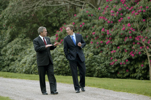 President George W. Bush and British Prime Minister Tony Blair walk through the grounds of Hillsborough Castle in Northern Ireland, Monday, April 7, 2003.