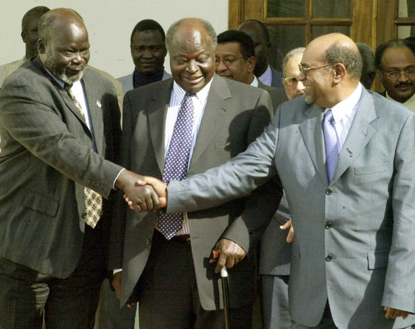 President Omar Hassan El-Bashir of Sudan, at right, greets the Sudan Peoples Liberation Army leader John Garang, at left, after they issued a joint communiqu� following their meeting at the State House in Nairobi, Kenya, on April 2, 2003. The talks were chaired by President of Kenya, Mwai Kibaki, at center.