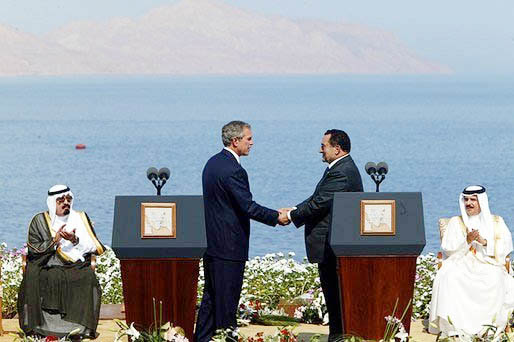 President George W. Bush and President Hosni Mubarak of Egypt after delivering statements on the progress of the Red Sea Summit in Sharm El Sheikh, Egypt June 3, 2003.
