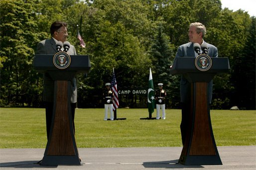 Presidents Pervez Musharraf of Pakistan and George W. Bush hold a joint press conference at Camp David Tuesday, June 24, 2003.
