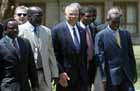 October 22,2003: Secretary Powell walks with Kenya's Foreign Minister Kolonzo Musyoka (L) an with Sudan People's Liberation Movement (SPLM) leader Dr John Garang (2nd from L), and Sudan's First Vice President Ali Osman Mohamed Taha, in the Kenyan town of Naivasha, 90 kms from the capital Nairobi. The Government of Sudan and the SPLM met with Secretary Powell and are hoping to sign a comprehensive peace agreement with power and wealth sharing by the end of December in talks aimed at ending the 20 year civil war. EPA photo by Stephen Morrison.