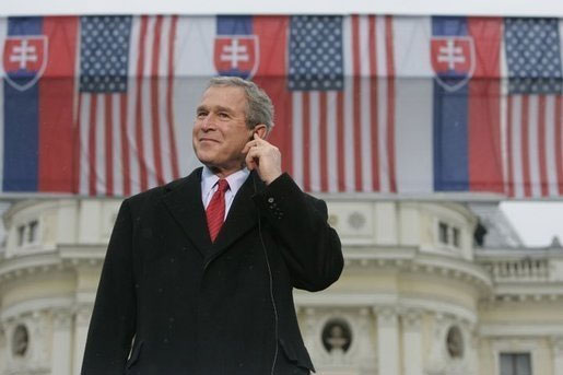 President George Bush listens to Slovak Prime Minister Mikulas Dzurindas introduction before giving remarks at Hviezdoslavovo Square in Bratislava, Slovakia
