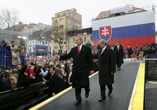 President George W. Bush gives his thumbs up as he leaves the stage with Prime Minister Mikulas Dzurinda of Slovakia after speaking at Hviezdoslavovo Square in Bratislava, Slovakia.