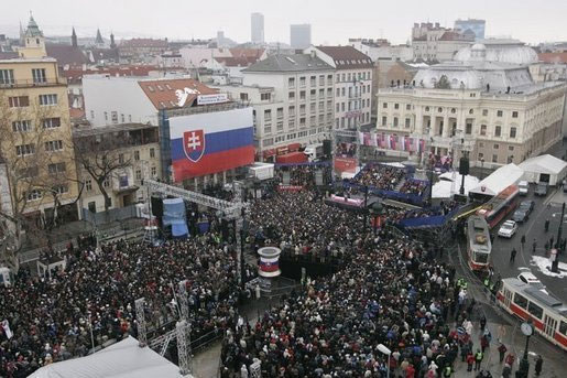President George W. Bush and Slovakia's Prime Minister Mikulas Dzurinda are greeted by a crowd of thousands gathered in Bratislavas Hviezdoslavovo Square