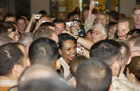 During a surprise visit to Iraq on May 15, Secretary Rice is surrounded by troops.  Photo courtesy SSgt Jeromy Cross, USAF/Combat Camera Iraq.
