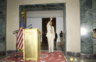 Secretary Rice waves as she approaches the podium at the U.S. Embassy Baghdad during her surprise visit to Iraq. State Department photo.