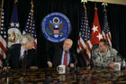 Vice President Dick Cheney, center, accompanied by U.S. Ambassador to Iraq Ryan Crocker, left, and Gen. David Patraeus, commander of the U.S. forces in Iraq, right, takes part in a news conference in Baghdad, Iraq, Wednesday, May 9, 2007.