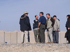 Deputy Assistant Secretary for International Narcotics and Law Enforcement Affairs Tom Schweich talks with U.S. local staff at the base in Kandahar province where air support is being provided to Afghan crop reduction workers.