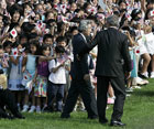 President Bush escorts Japanese Prime Minister Junichiro Koizumi during an arrival ceremony on the South Lawn of the White House Thursday, June 29, 2006 in Washington. [�AP/WWP]