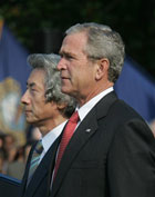 President Bush and Japanese Prime Minister Junichiro Koizumi take part in arrival ceremony.