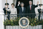President Bush, first lady Laura Bush and Japanese Prime Minister Junichiro Koizumi wave from the Truman Balcony during an arrival ceremony on the South Lawn of the White House Thursday, June