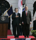 President Bush and Japanese Prime Minister Junichiro Koizumi stand for the national anthem