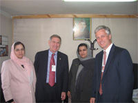 Judge David Carter (second from left) and Robert O'Brien with two Afghan women judges of the Criminal Justice Task Force in Kabul. [State Dept. photo]