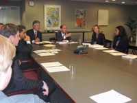 Ambassador Tom Schweich (pictured at center) addresses the Executive Committee. [State Dept. photo]
