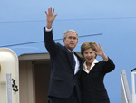 President George W. Bush and Mrs. Laura Bush wave upon their Romanian arrival, April 1, 2008, at Henri Coanda International Airport in Bucharest, site of the 2008 NATO Summit. [White House photo]