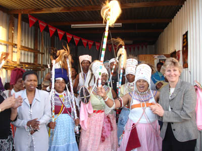 Under Secretary Hughes poses with a group of South Africa traditional healers known as Snagomas in the township of Masiphumelele [State Department Photo 4/06].