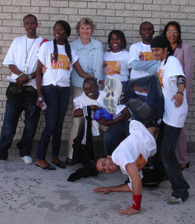 Under Secretary Karen Hughes poses with members of The Players hip hop group [State Department Photo 4/06].