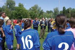 Coach Dorrance reviews game strategy with the Moldovan girls team before the exhibition match, May 10, 2008. [Alexandru Leanca, U.S. Embassy Chisinau]