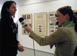 Consular Officer Ann Meceda, who opened the exhibit, is interviewed by Televizia  Karpaty, May 5, 2008. [Lea Mala, U.S. Embassy Bratislava]