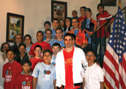 Juan Carlos Navarro, a Spanish NBA player, with student participants from  embassy basketball programs, April 29, 2008. [Margaret Bond, U.S. Embassy Madrid]