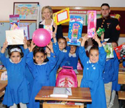 Turkish schoolchildren show off their new gifts with DCM McEldowney and MSG Corporal Nouhan, October 2007. [Atilla Tunali, U.S. Embassy Ankara]