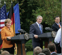From left: German Chancellor Merkel,  President Bush, and European  Commission President Barroso at a joint press conference at the U.S.-EU  Summit, April 30, 2007. [White House photo by Eric Draper]