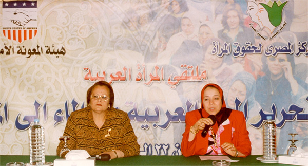 Two women sitting at table, Cairo, Egypt, May 2003.