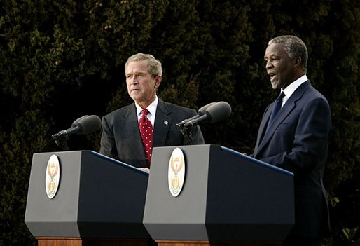 Presidents Bush and Mbeki speak to the media at the Guest House in Pretoria, South Africa, Wednesday, July 9, 2003.