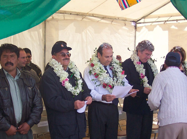 Assistant Secretary Noriega [center] and Ambassador to Bolivia David Greenlee [right] wear traditional leis at the inauguration of a U.S.-funded road project in El Alto, Bolivia. State Dept. Photo.