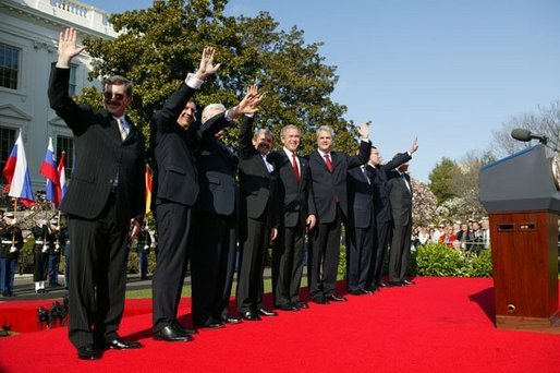President George W. Bush waves with Prime Ministers of seven countries after a South Lawn ceremony welcoming them into NATO Monday, March 29, 2004. From left are: Prime Minister Indulis Emsis of Latvia, Prime Minister Anton Rop of Slovenia, Prime Minister Algirdas Brazauskas of Lithuania, Prime Minister Mikulas Dzurinda of the Slovak Republic, President George W. Bush, Prime Minister Adrian Nastase of Romania, Prime Minister Simeon Saxe-Coburg Gotha of Bulgaria, Prime Minister Juhan Parts of Estonia, and NATO Secretary General Jaap de Hoop Scheffer. White House photo by Susan Sterner.