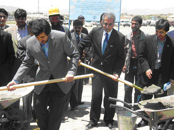 Minister of Commerce, Sayed Mustafa Kazemi, and U.S. Special Presidential Envoy and Ambassador Zalmay Khalilzad, lay the first cement for the cornerstone of the Bagrami Industrial Park in Kabul, due t