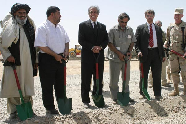 U.S. Ambassador Zalmay Khalilzad broke ground with the Governor of Oruzgan, Minister of Public Works, Governor of Kandahar, USAID Afghanistan Director, Patrick Fine, and U.S. Major General Olson for the Kandahar to Tirin Kot Road on Thursday, September 9th. By cutting the drive time from 12 hours to 3 hours, the 130km road will restore a valuable trade route between two key southern cities in Afghanistan - improving security, commerce and access to health care and education for tens of thousands of Afghans. The road is funded by the U.S. Agency for International Development and will be built by the U.S. Army's 528th Engineer Battalion. It is expected to be completed by the end of 2005 and will cost approximately $20 million. State Department Photo.