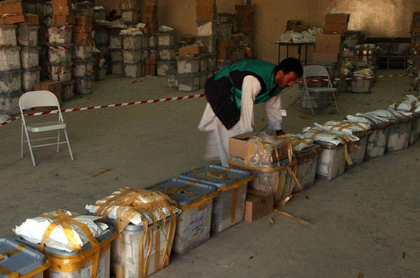 Man sorting ballot boxes in Kabul, Afghanistan, Oct. 12, 2004. �AP/Wide World Photo