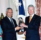 Secretary Powell presents an Award for Corporate Excellence to David H. Gilmour, Founder and Chairman, FIJI Water. State Dept. Photo.