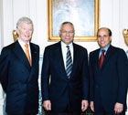 Secretary Powell stands with Award for Corporate Excellence winners David H. Gilmour, Founder and Chairman, FIJI Water [left] and Edward J. Zander, Chairman and CEO, Motorola. State Dept. Photo.
