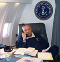 Secretary Powell in his cabin on his plane. As U.S. Secretary of State, Secretary Powell has traveled 698,015 miles. State Department Photo