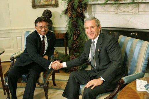 President George W. Bush and Pakistan President Pervez Musharraf pose during a photo-op in the Oval Office Saturday, Dec. 4, 2004