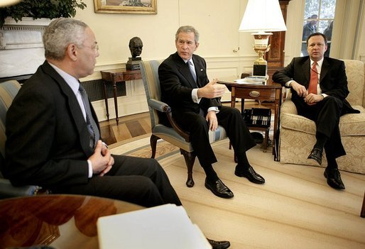 President George W. Bush talks with State Secretary Colin Powell and FEMA Director Mike Brown, far right, during an Oval Office briefing on the tsumami relief efforts Monday, Jan. 10, 2005.
