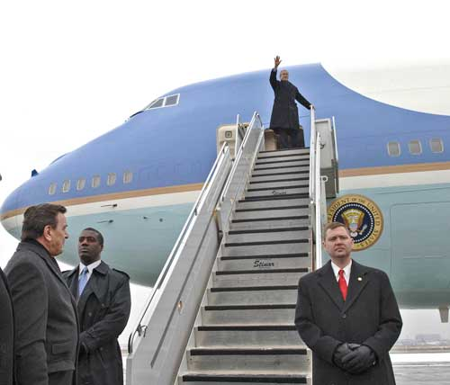 President Bush steps out of Air Force One, as German chancellor Schroeder looks on, Frankfurt, Germany, Feb. 23, 2005. AP photo/Julia Fassbender/Bundespresseamt