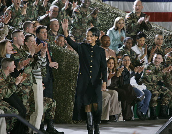 Secretary Rice is applauded as she arrives to introduce President Bush and first lady Laura Bush to American troops based in Germany at the Wiesbaden Army Airfield, Wednesday, Feb. 23, 2005.