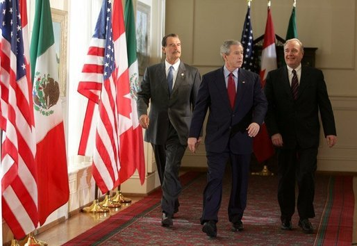 President Bush walks with Mexico President Fox, left, and Canadian Prime Minister Martin upon their arrival Wednesday, March 23, 2005, at the Bill Daniels Activity Center at Baylor University in Waco, Texas.