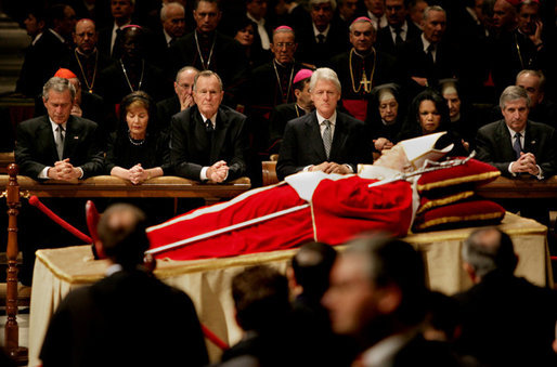 Pictured from left, President George W. Bush, Laura Bush, former President George H. W. Bush, former President Bill Clinton, Secretary of State Condoleezza Rice and White House Chief of Staff Andy Card pay their respects to Pope John Paul II as he lies in state in St. Peter's Basilica at the Vatican Wednesday, April 6, 2005.