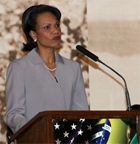 Secretary Rice delivers a speech as others look on, Brasilia, Brazil, April 27, 2005. State Dept. photo.