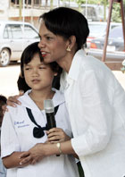 Secretary Rice hugs a Thai school girl after she led a group singing for her at Bang Sak school which was devastated by the last December's tsunami and was rebuilt as part of the U.S. reconstruction efforts in Pang-nga province, southern Thailand.