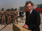 Deputy Secretary Zoellick speaks to a gathering of troops from nine coalition nations, including soldiers from Slovakia, seen left, during a visit to Camp Charlie in Hilla, Iraq, Tuesday, July 12, 2005.  AP/Wide World photo
