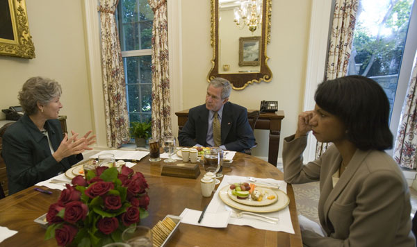 President Bush has lunch with Secretary Rice and Under Secretary Hughes at the White House. White House photo